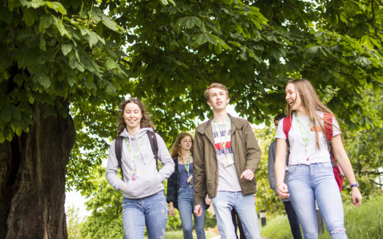 Students walking through arboretum 175