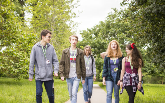Students walking through arboretum 212