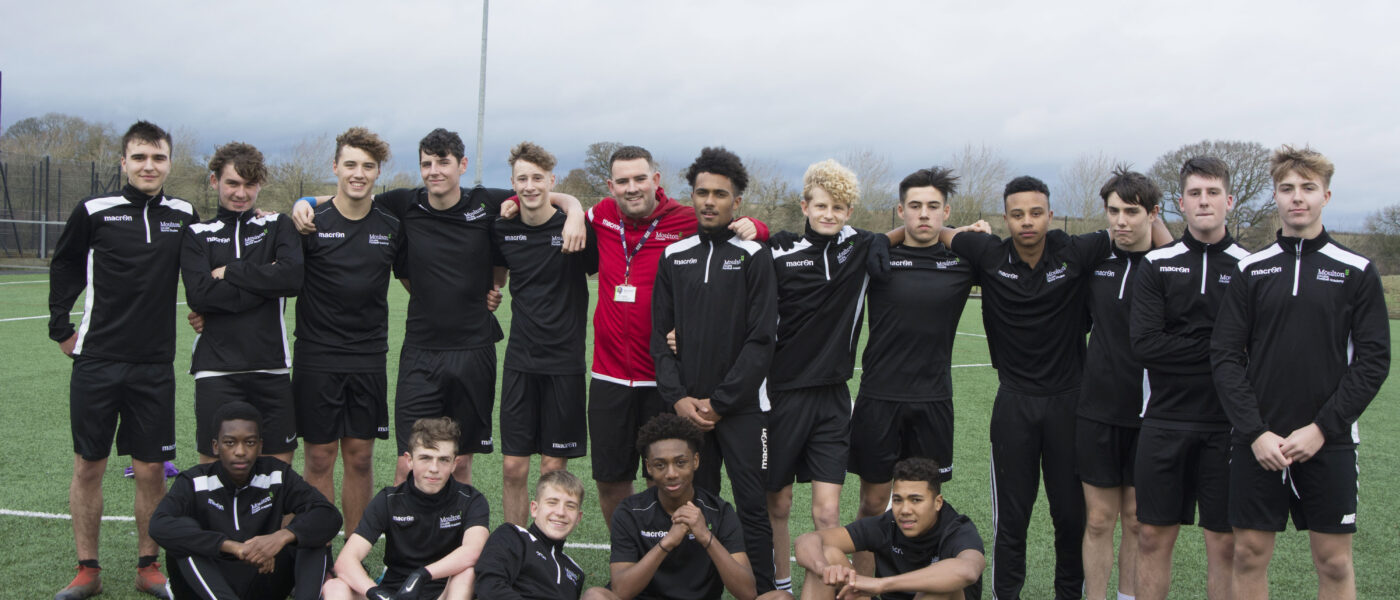 Tim Dudding Head of Football at Moulton College with Academy players